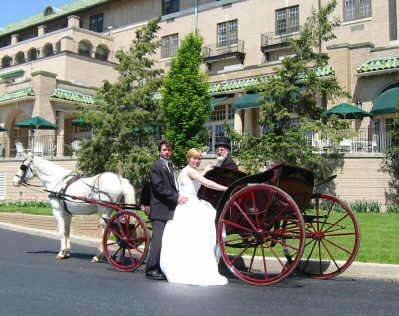Bride and groom stepping into a horse drawn carriage in front of the prestigous Hotel Hershey
